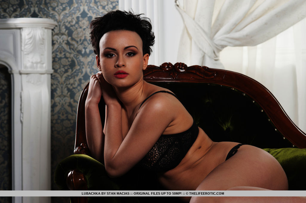 Sultry chic Lubachka in matching black lace lingerie that accentuates her edgy look and seductive confidence.