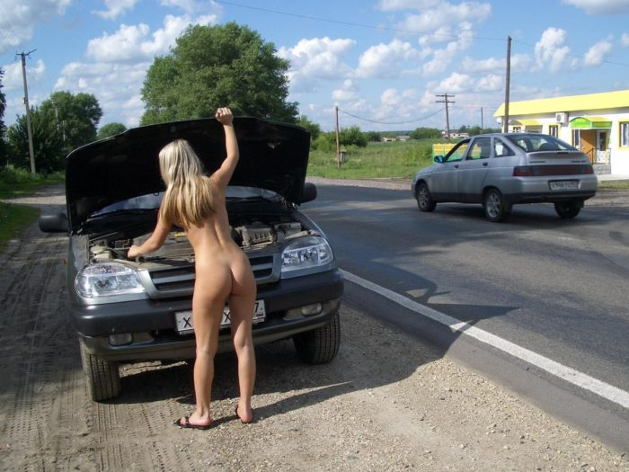 The naked girl broke down the car on the track