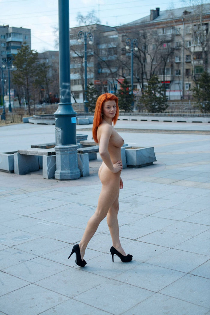 Amazing busty redhead babe walks only in shoes