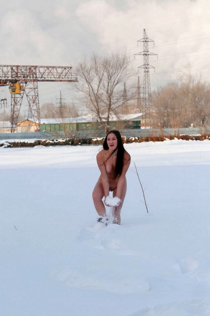 Busty russian girl Inna plays with a snow