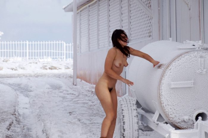 Girl with a hairy pussy walks through very cold streets