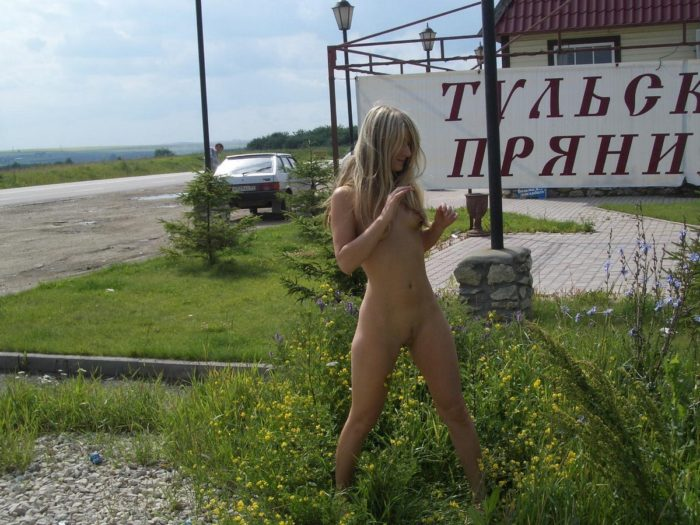 Girl without clothes at a gas station
