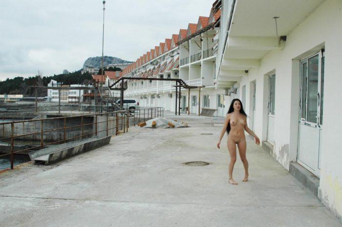 Hot russian brunette posing naked on embankment