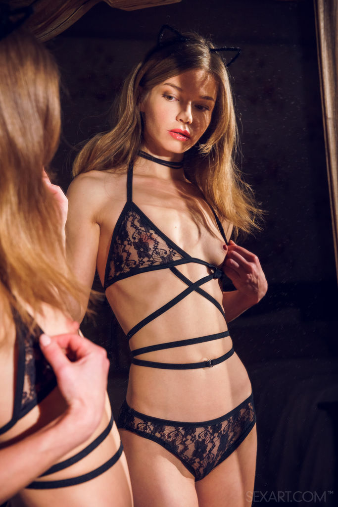 Nedda A poses in her delicate black lace lingerie and matching thigh stockings