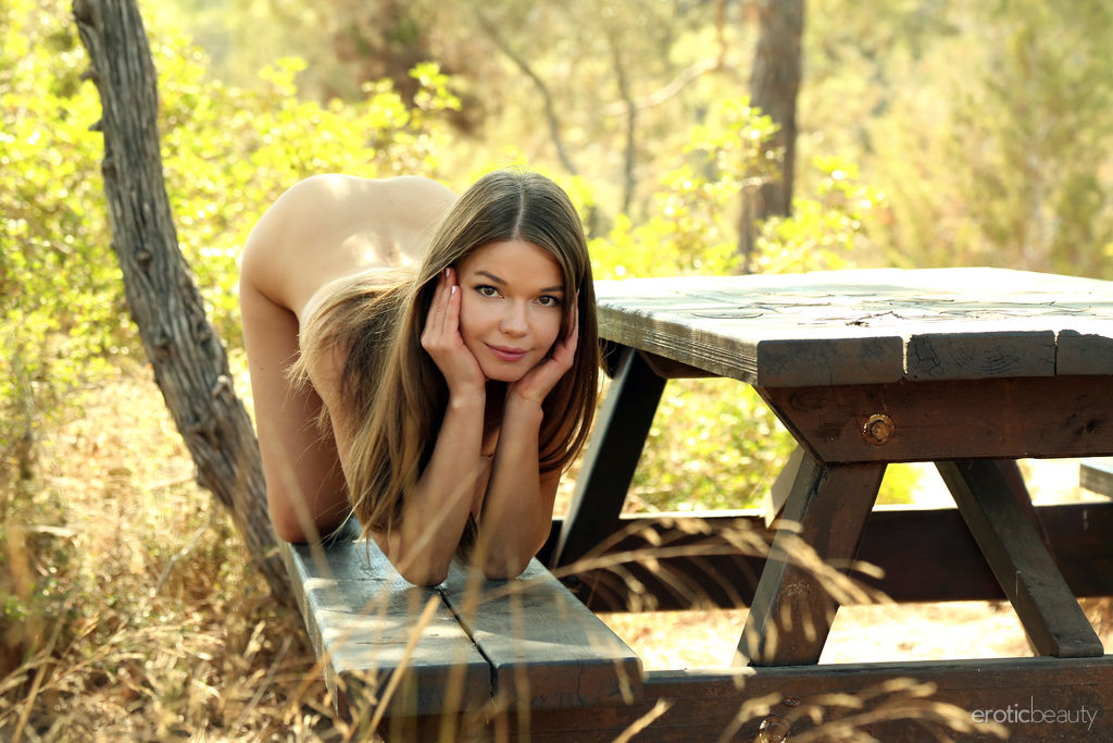 Nedda A shows off her petite body as she poses on the picnic table.