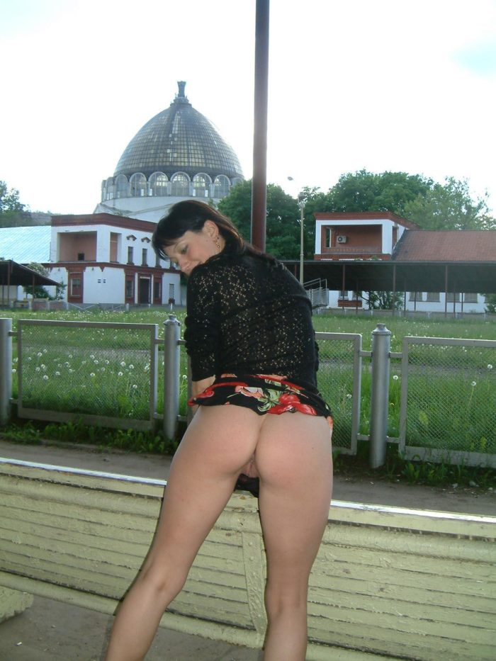 Russian brunette with no panties flashes at public park