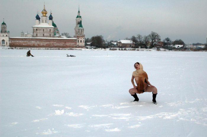 Russian teen Tamara K plays with shawl at snow field