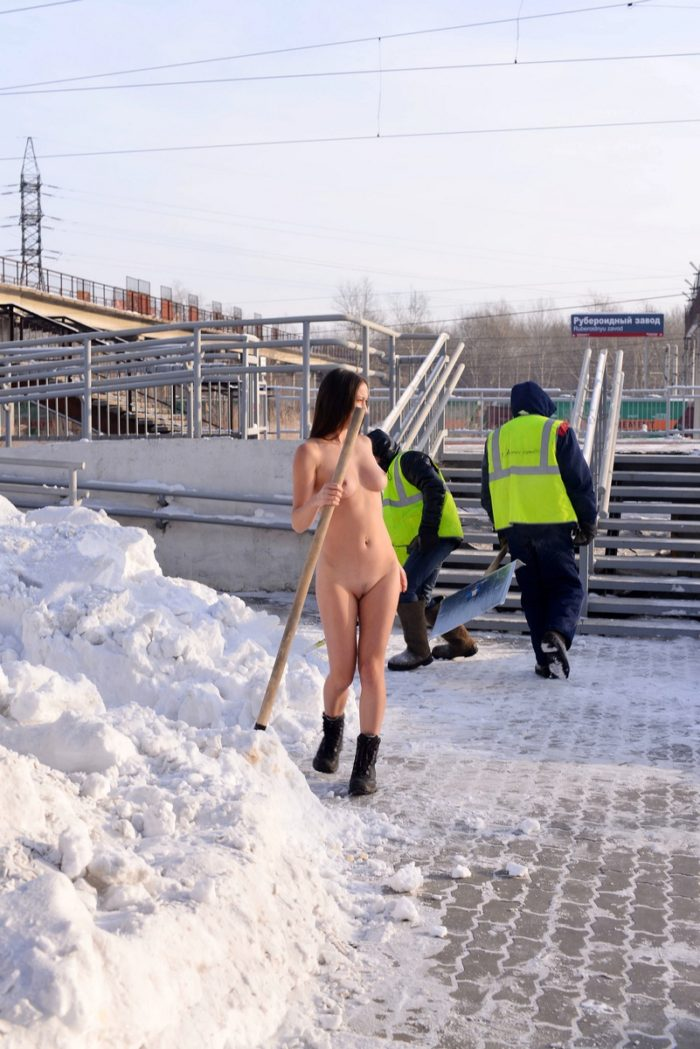 Sexy russian girl with nice boobs helps workers with snow