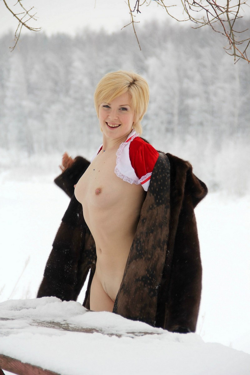 Short Haired Blonde Doing Exercises On A Snowy Table Russian
