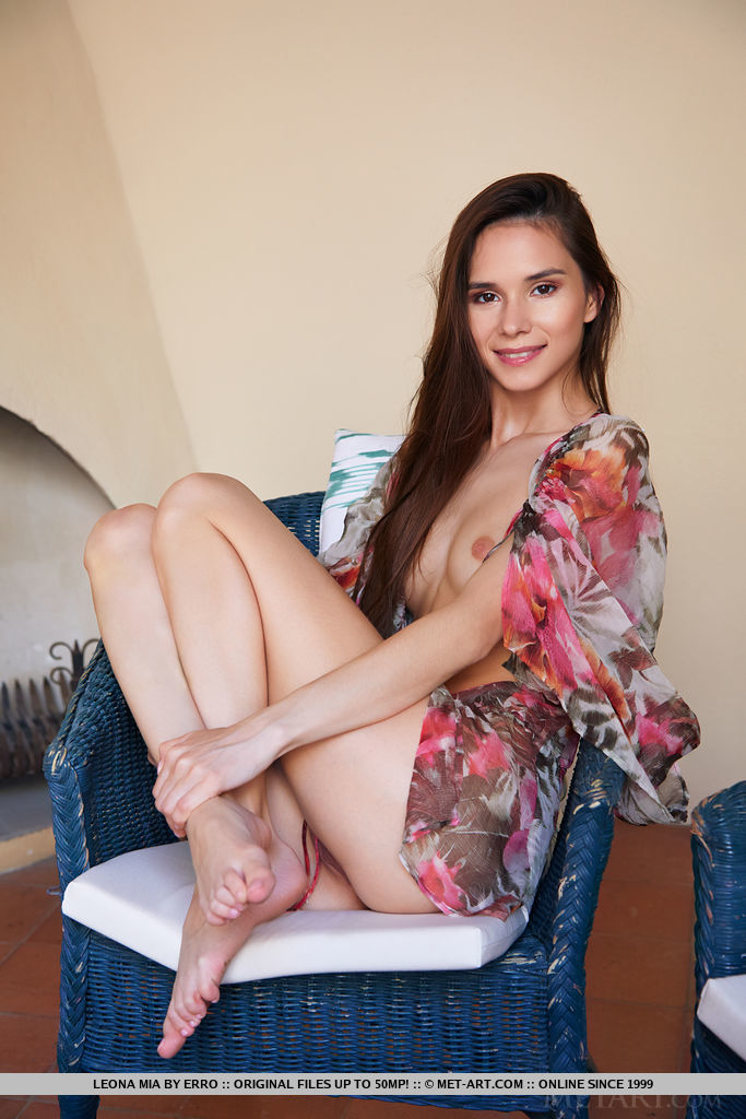 Top model Leona Mia flaunts her petite body and creamy body on the chair.