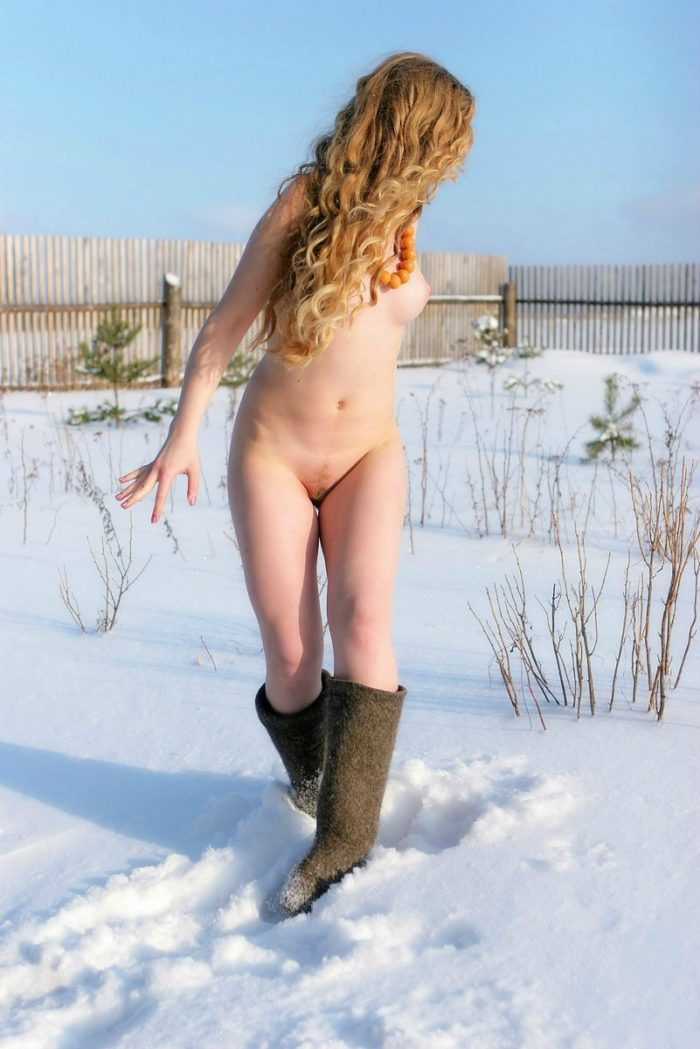 Two young girls plays with snow after sauna session