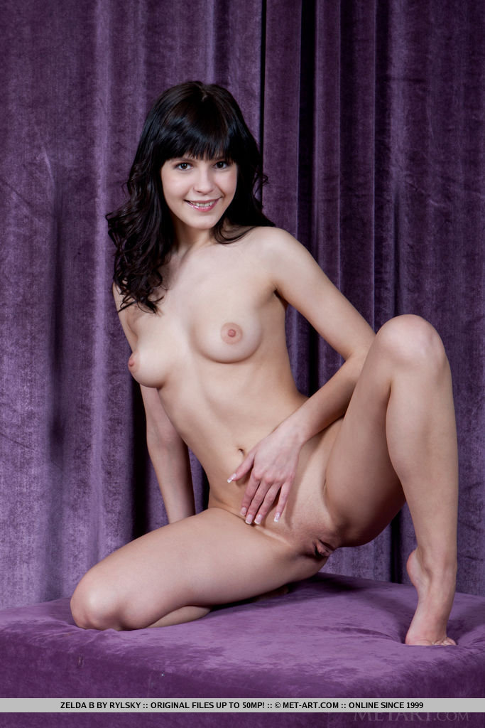 Zelda B may look sweet and innocent but this cute charmer with the angelic face and beguiling smile is a real tease, bending, spreading, and posing her body and limbs into a variety of provocative poses.