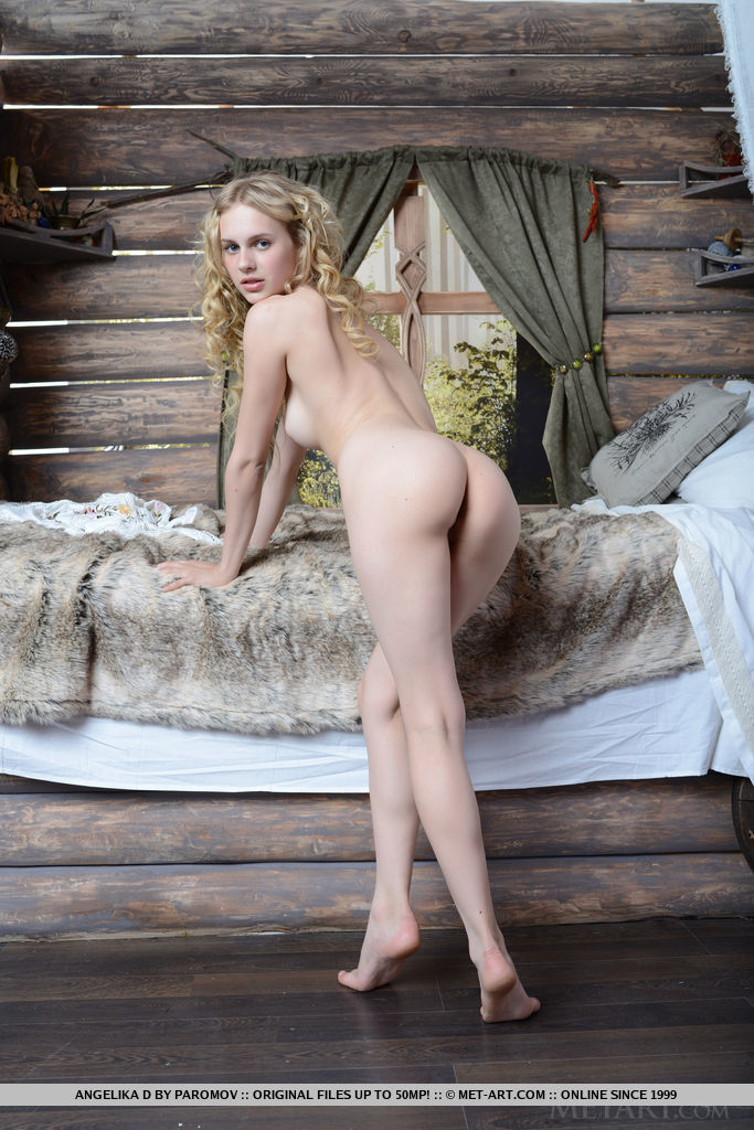 Angelika D strips naked for an intimate showcase of her slender, pale body, pink perky nipples, and smooth, svelte limbs.