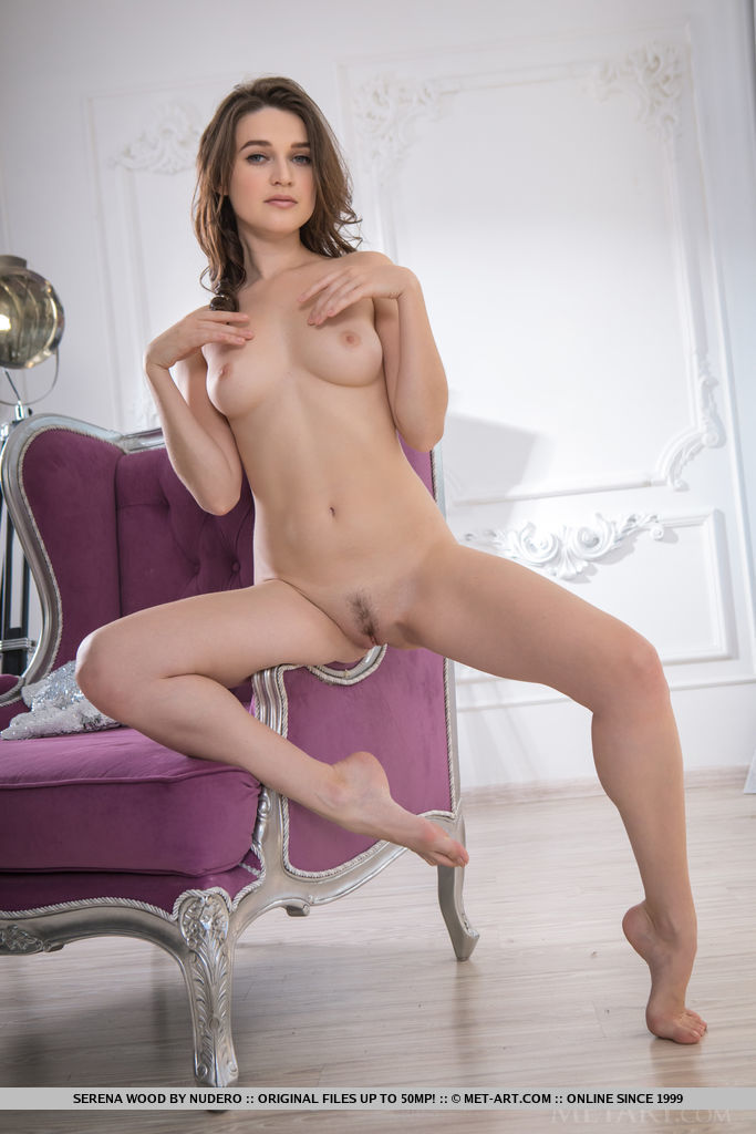 Beautiful Serena Wood sensually strips in front of the mirror.