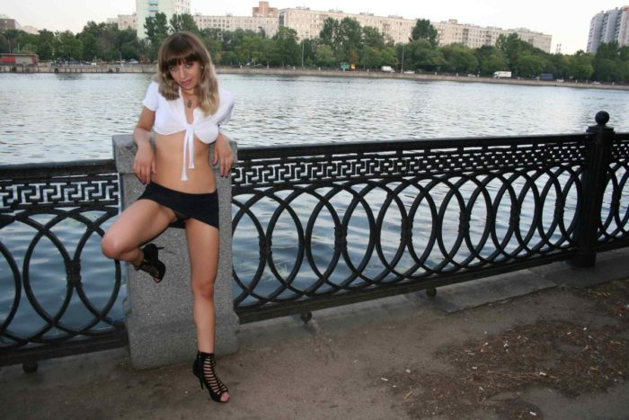 Blonde in mini-skirt shows her goods