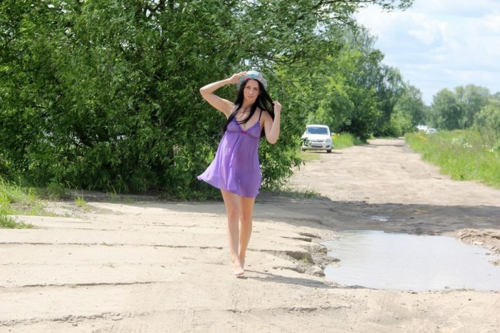 Brunette Veronica Snezna removes her purple dress to show pussy