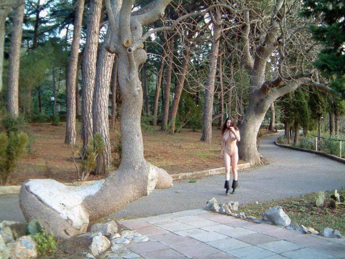 Busty brunette Julia S posing at public park