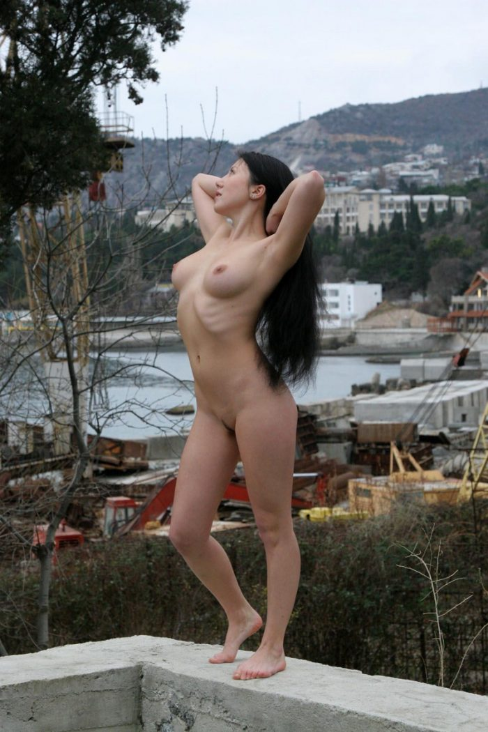 Busty brunette on industrial facility naked