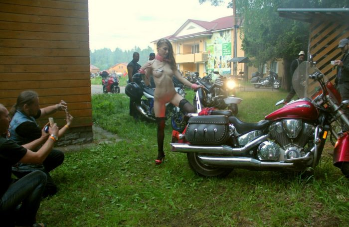 Crazy russian blonde posing in front of many bikers