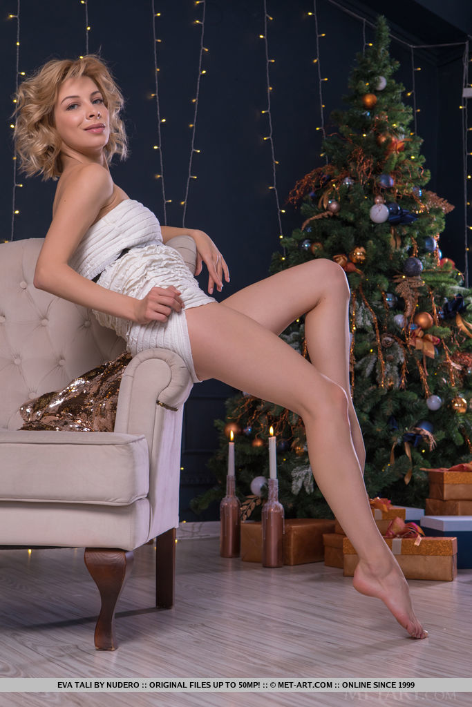 Eva Tali bares her amazing tight body as she opens her present.