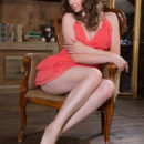 Gorgeous Ginger Frost displays her sweet ass and yummy pussy on the chair.