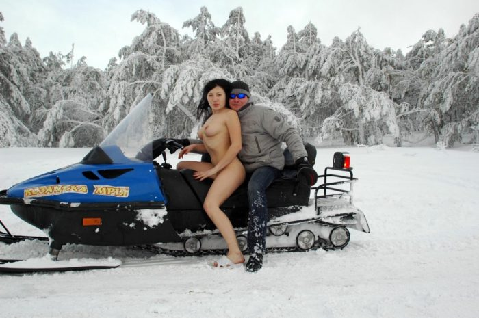 Nude russian girl wants to ride a snowmobile