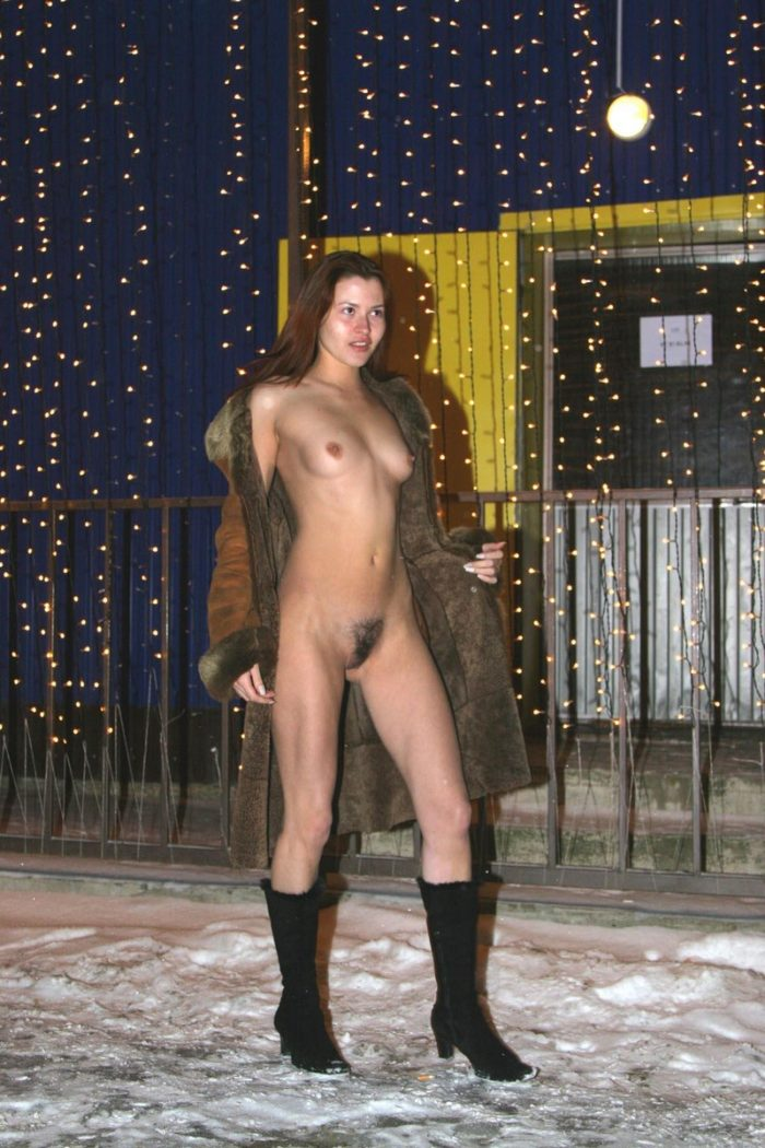 Redhead girl Tamara K with slender body takes off sheepskin coat