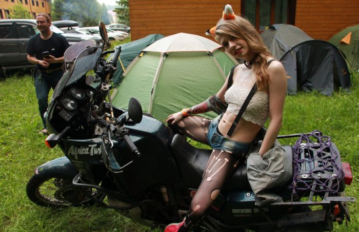 Sexy Inessa posing in very sexy clothes at bikers camping