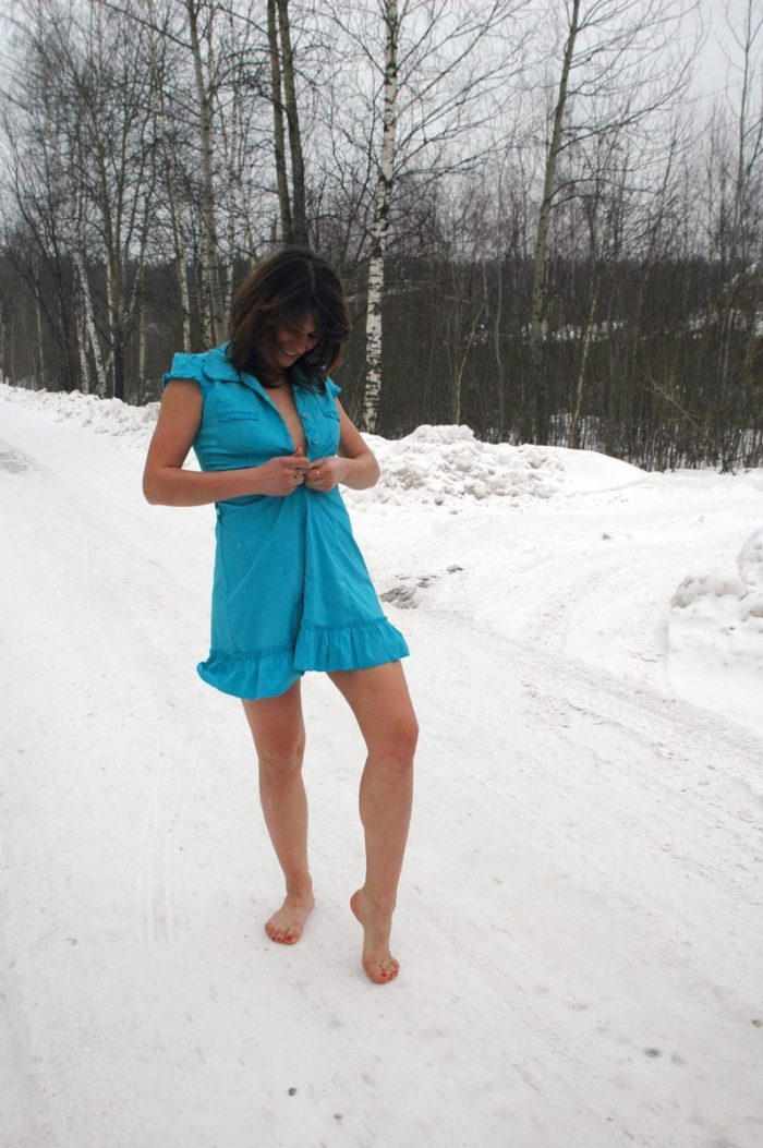 Sexy dame undresses outdoors at winter