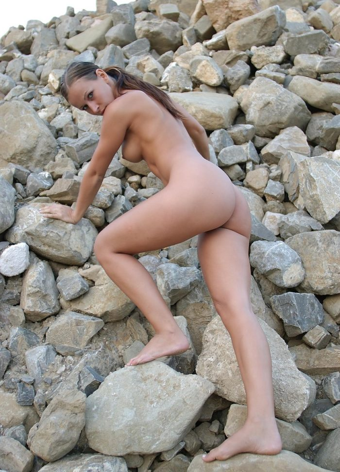 Sexy russian girls with sporty body posing on the rocks