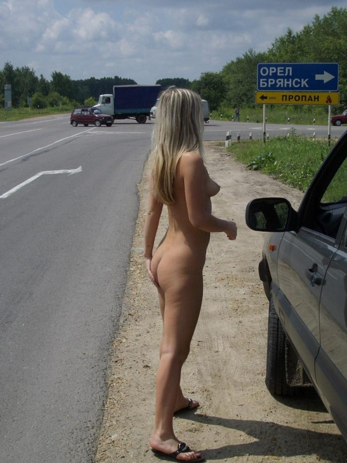 The girl likes to drive a car without clothes