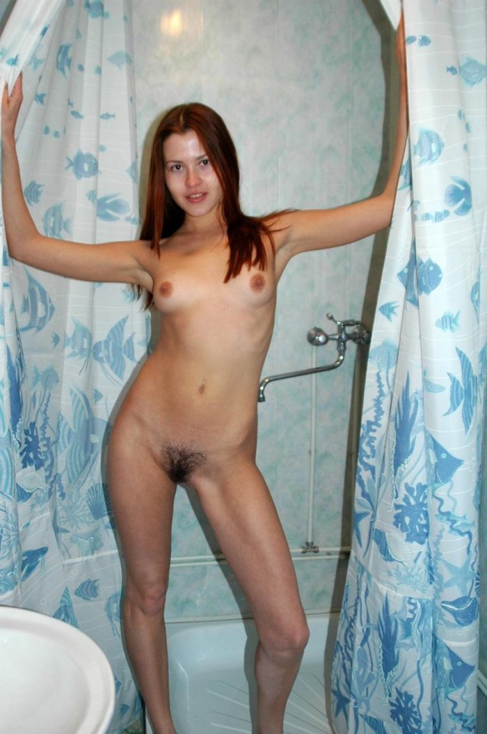 Young redhead Tamara K takes a shower