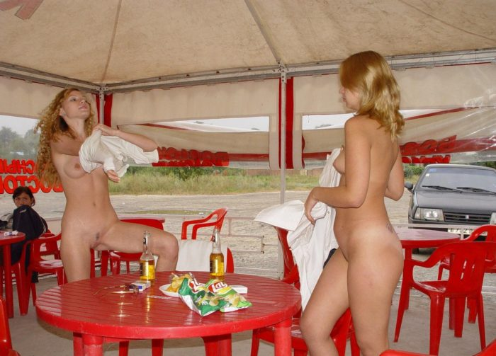 Young russian blondes drink beer and lick pussies at outdoors cafe