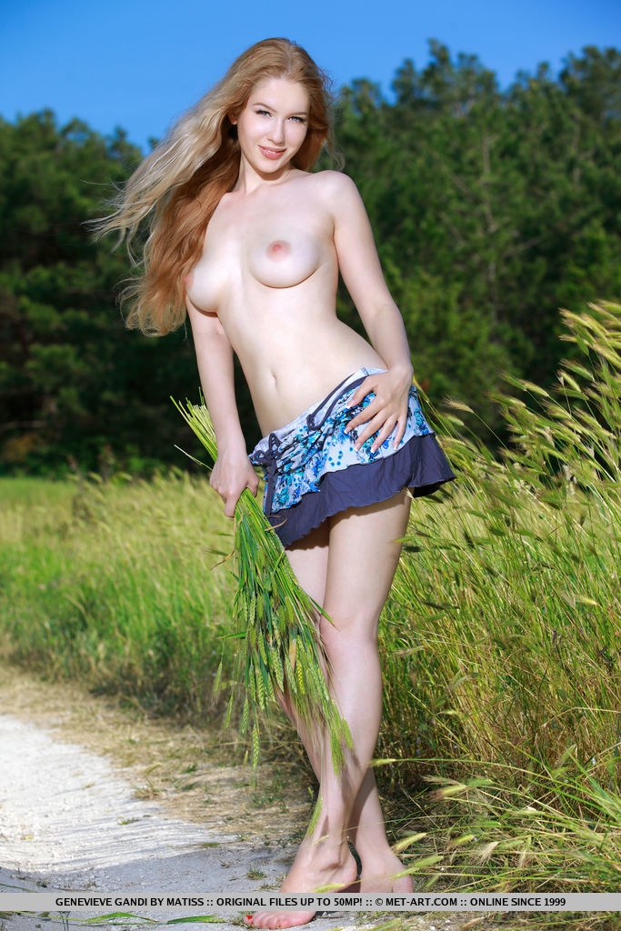 Genevieve Gandi flaunts her sexy, creamy body and pink pussy as she strips in the field.