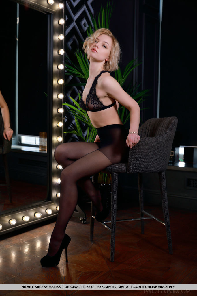 Hilary Wind sensually strips in front of the mirror as she bares her amazing physique.