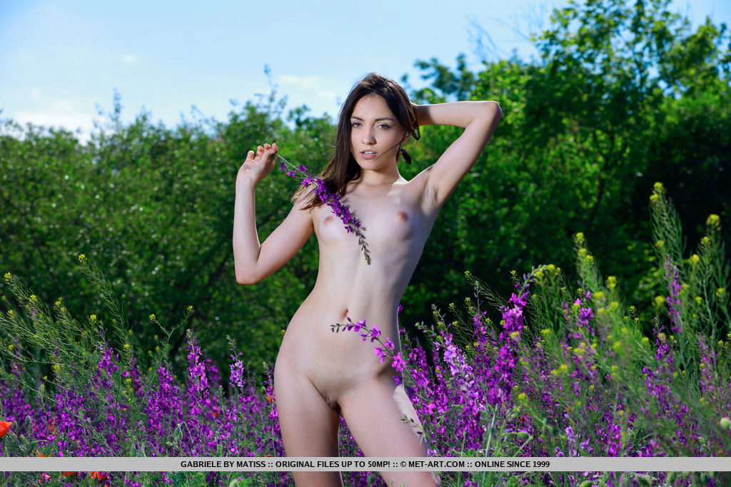 Newcomer Gabriele strips on the field as she flaunts her tight body.