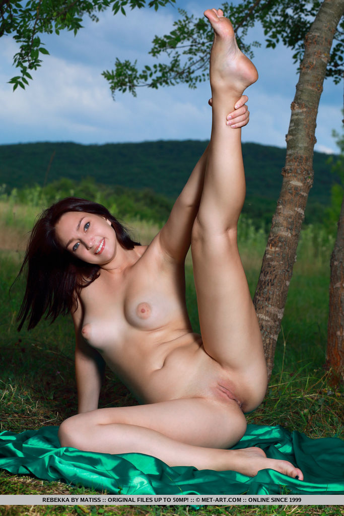 Newcomer Rebekka shows off her beautiful tits and curvy hips as she strips outdoors.