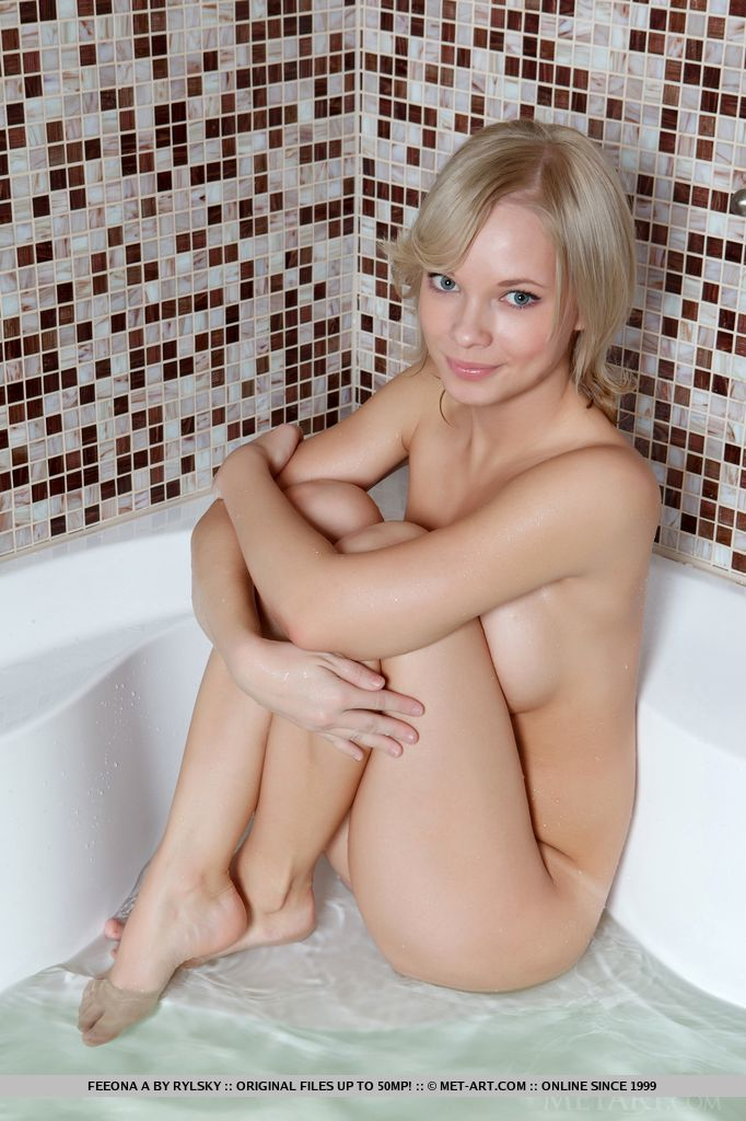 Petite yet lusty bod that captures the attention, along with a natural, amateur beauty, and sweet, innocent appeal, Feeona A teases her way from the bed to the bathtub.