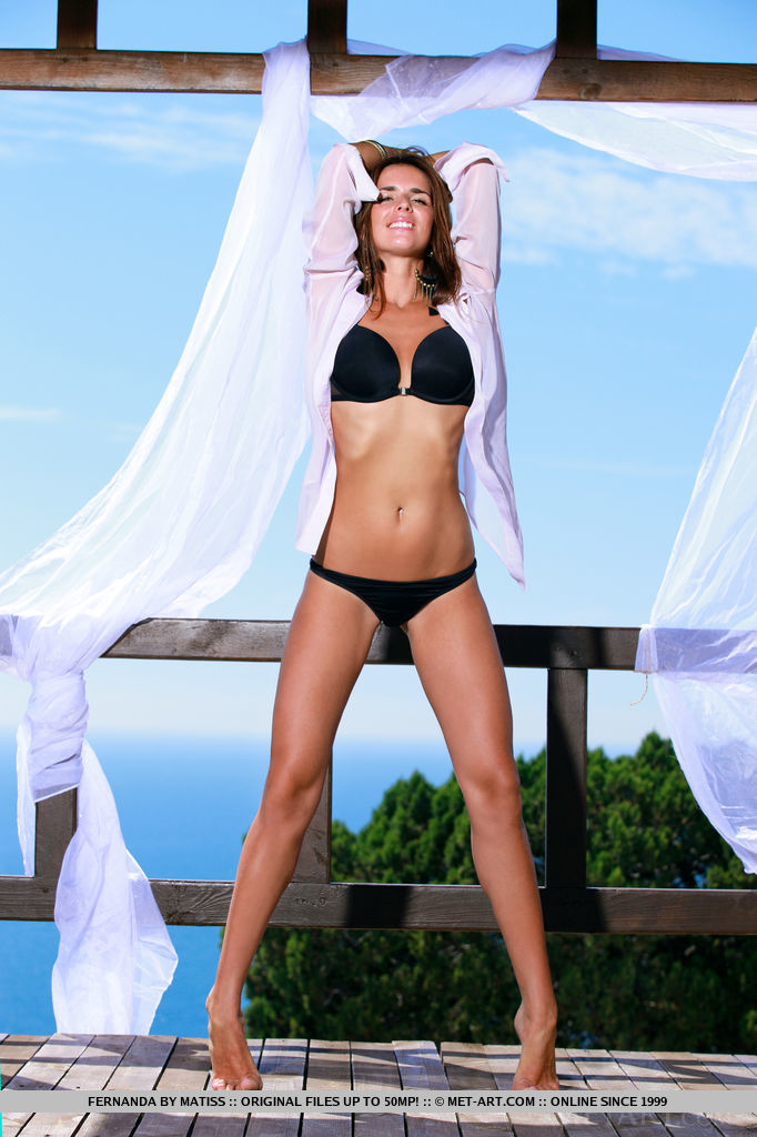 Wearing a matching black lingerie, Fernanda poses against the azure sky as her backdrop. Wind-blown hair and the sun kissing her smooth, tanned body, she s a hot newcomer that you would love to see more of.