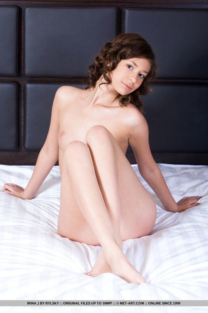 Elegant and seductive, Irina J performs a titillating posing on top of the bed with lots of sultry, provocative poses.