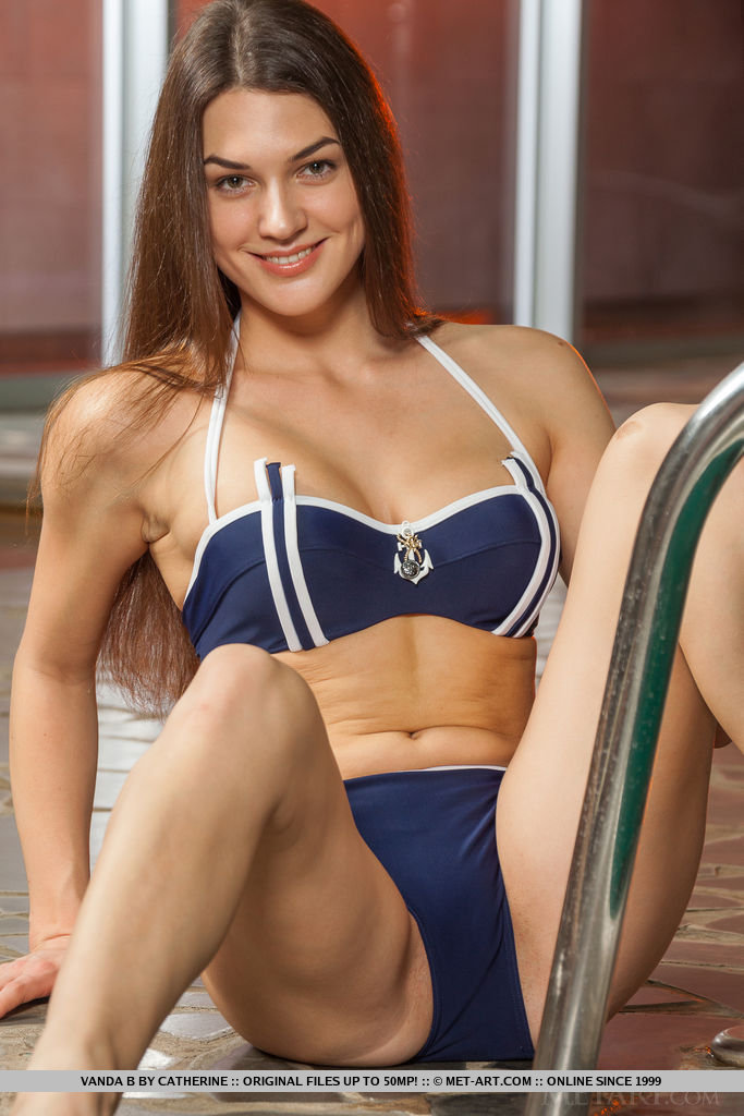 Have some  hot summer  fun poolside with Vanda B. Wearing a sexy, two piece navy blue and white bikini she is sure to captivate and ensnare you.