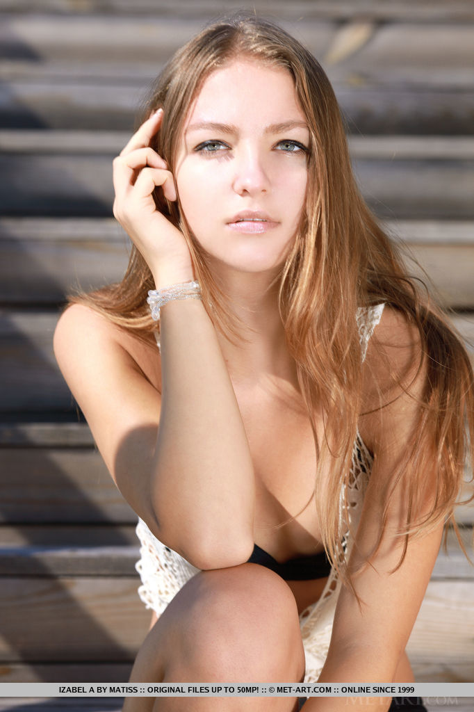 Long, wind-swept hair, green eyes with sultry stare, petite yet pink breasts, and lots of erotic poses, Izabel A s seductive beauty stands out naturally.