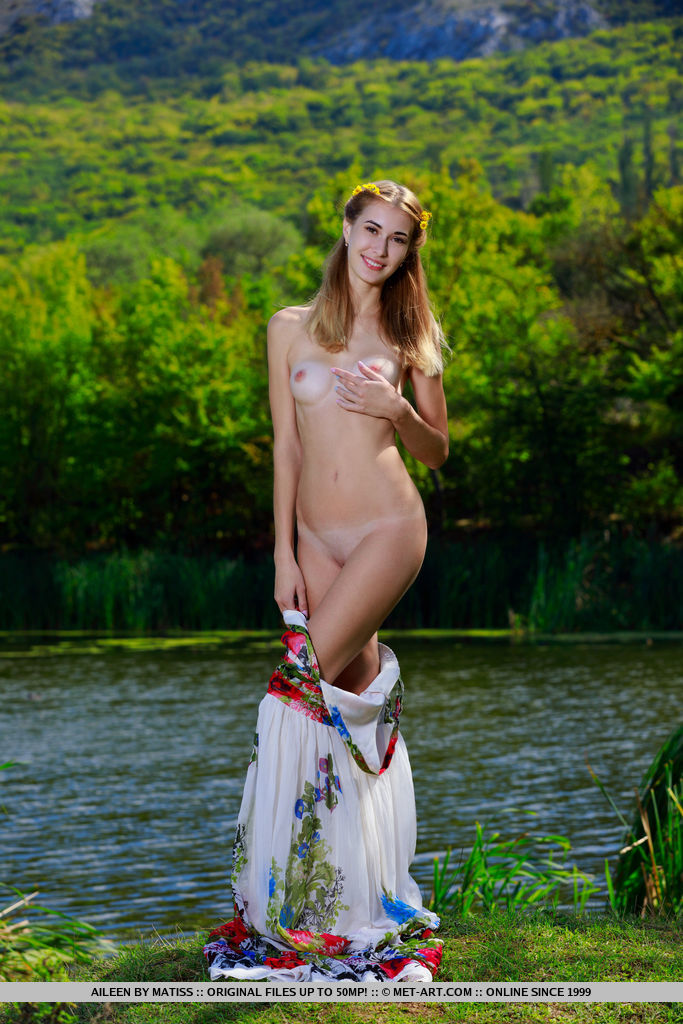 Aileen bares her petite, tanned body as she strip by the river.