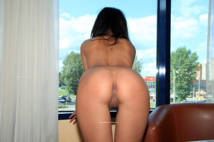 Asian-russian brunette Alina S posing at window