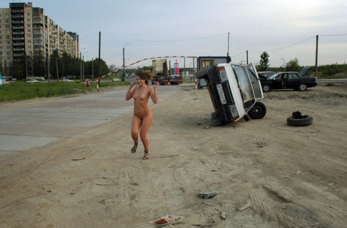 Beautiful girl Oksana E near a repaired car