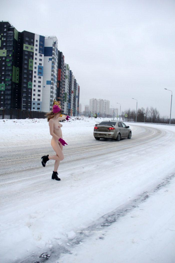 Blonde Seshat walks naked at road