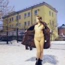 Girl Zhenja undresses at city streets