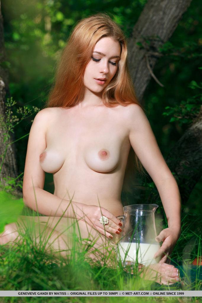 Gorgeous blonde Genevieve Gandi pours milk all over her creamy body.