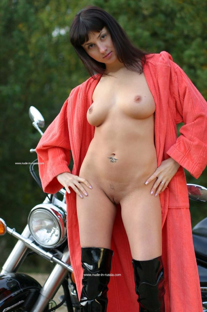 Hot brunette Katja T posing on motorcycle