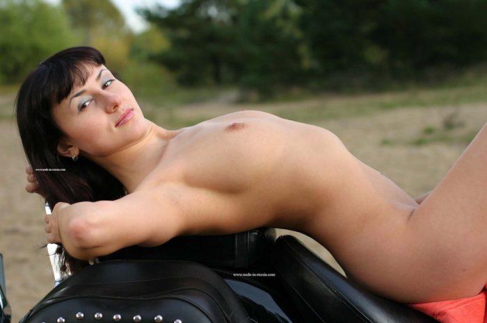 Hot brunette Katja T posing on motorcycle